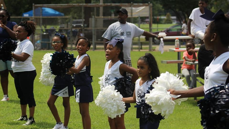 Young cheerleaders at practice