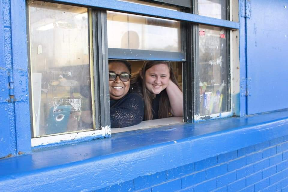 Women smiling in the concessions booth