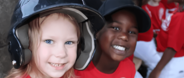 Smiling tee-ball players